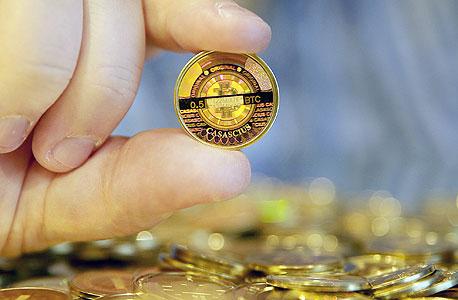 מטבע ביטקוין, צילום: בלומברג