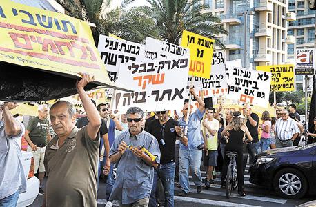 הפגנה שערכו תושבי גבעת עמל ביולי 2013 נגד הכוונה לפנותם