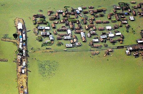 הצפות במג'ולי. יותר מחצי משטח האי אבד בתוך מאה שנה