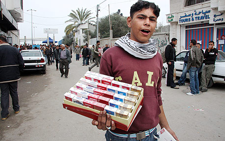 A youth selling cigarettes in Gaza. Photo: Bloomberg