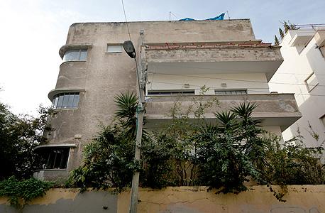 """בניין ברחוב חיסין בתל אביב. """"יש להתמודד עם מרכז העיר המתפורר"""""""