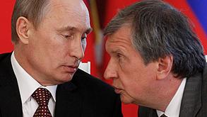 """נשיא רוסיה ולדימיר פוטין (משמאל) ומנכ""""ל רוסנפט איגור סצ"""