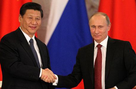 ולדימיר פוטין ונשיא סין שי ג'ינפינג, צילום: אי פי איי