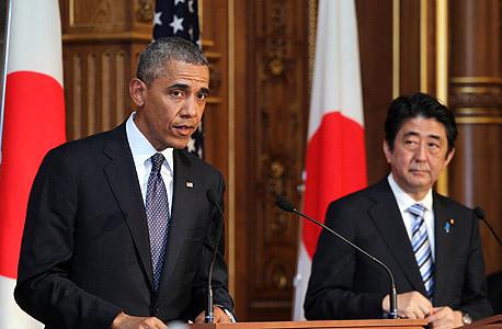 ברק אובמה שינזו אבה ראש ממשלת יפן, צילום: בלומברג