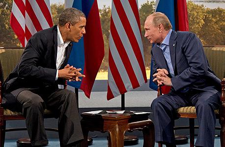 """ולדימיר פוטין וברק אובמה. פוטין ואובמה. """"המשבר החמור ביותר בעשורים האחרונים"""", צילום: אי פי"""