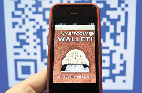 קפיטליזם 3.0 אפליקציית ארנק ביטקוין, צילום: בלומברג