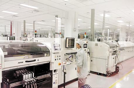 מפעל בסין (ארכיון), צילום: הראל עילם