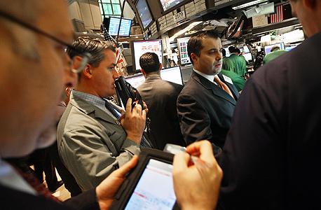 """וול סטריט: דאו ג'ונס עלה השבוע ב-1.3% ונאסד""""ק התחזק ב-0.8%"""