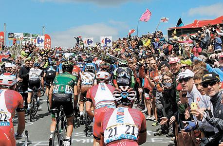 לפי המספרים האחרונים שפורסמו בבלומברג, ASO גלגלה ב־2013 כ־ 180 מילין יורו מעסקי מירוצי האופניים שלה והרוויחה 36 מיליון יורו, צילום: אי פי איי