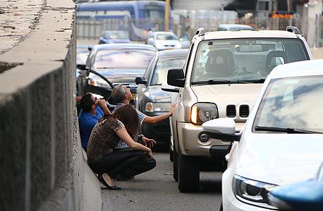 אזעקה בתל אביב במהלך מבצע צוק איתן, צילום: דנה קופל