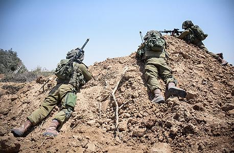 """לוחמים ב""""צוק איתן"""", צילום: דו""""צ"""