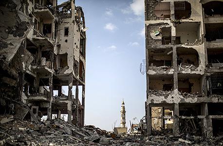 """שכונת בית להיא בצפון הרצועה, אתמול. """"אזור מוכה אסון"""", צילום: איי אף פי"""
