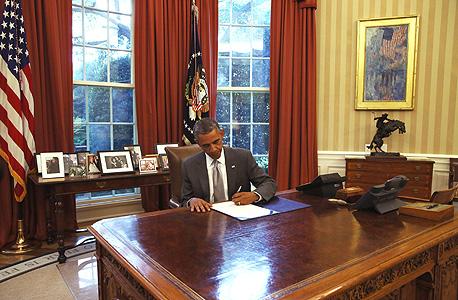 ברק אובמה חותם על החוק לסיוע חירום ל כיפת ברזל צוק איתן, צילום: אי פי איי