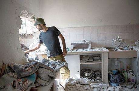 פגיעת רקטה ששוגרה על ידי חמאס בבית ב שדרות מבצע צוק איתן, צילום: אימג'בנק, Gettyimages