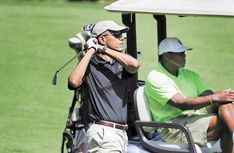 """נשיא ארה""""ב ברק אובמה מגרשי גולף, צילום: איי פי"""