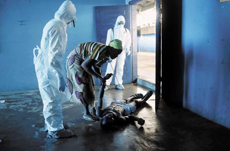 חולה אבולה בליבריה, צילום: אימג