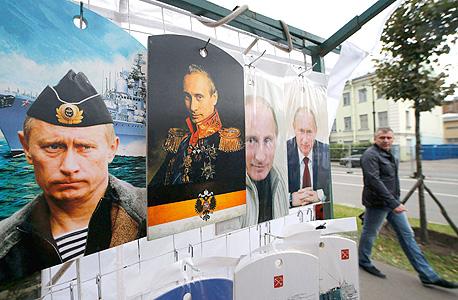 פוסטרים של נשיא רוסיה ולדימיר פוטין בסנט פטרסבורג, צילום: רויטרס
