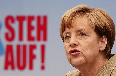 אנגלה מרקל קנצלרית גרמניה בעצרת נגד ה אנטישמיות ב ברלין, צילום: איי אף פי