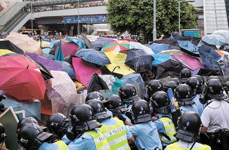 דיווח: סין מפיצה נוזקה שמרגלת אחרי סמארטפוני המפגינים בהונג קונג