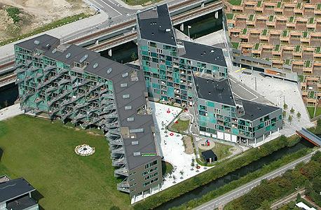 """בנייני רכבת חדשים בקופנהגן. אפרת: """"מגדלים מספקים רמת חיים אבל לא איכות חיים. האיכות מגיעה מחיים קהילתיים, ואת זה יש דווקא בשיכונים"""""""