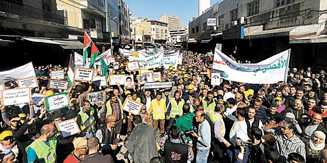 הפגנה בעמאן, צילום: רויטרס