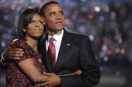 ברק ומישל אובמה, הכירו בעבודה כשהיא הייתה הממונה עליו, צילום: בלומברג