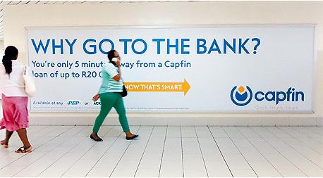 עוד  פרסומות להלוואות בקייפטאון, צילום: בלומברג
