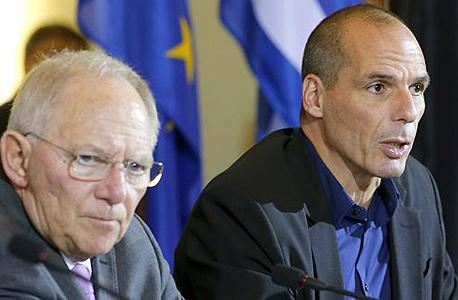 יאניס ורופיקס, שר האוצר של יוון (מימין) ושר האוצר הגרמני וולפגנג שויבלה