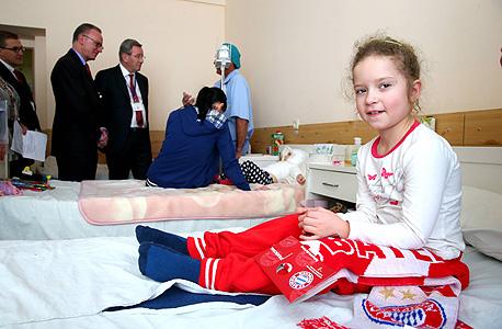 ילדה פצועה בלבייב. ברגע קרל היינץ רומינגה, צילום: אימג