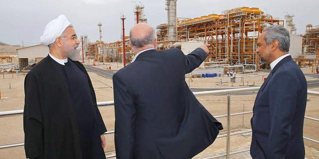 נשיא איראן חסן רוחאני ושר הנפט ביג