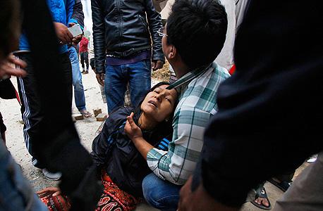 נפגעים מרעש האדמה, צילום: אי פיי