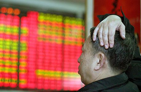 בורסת שנגחאי. הצניחה בשווקי העולם הדאיגה את חברי ה-FOMC, צילום: בלומברג