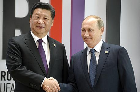 מימין ולדימיר פוטין נשיא רוסיה ו נשיא סין שי ג'ינפינג , צילום: איי אף פי