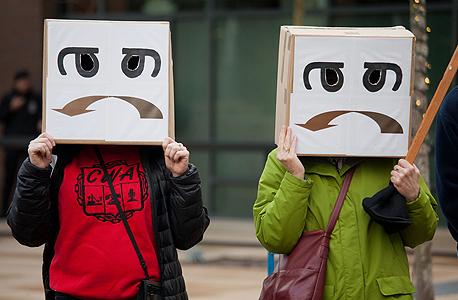 מחאת ארגוני העובדים במשרדי אמזון מוסף, צילום: בלומברג
