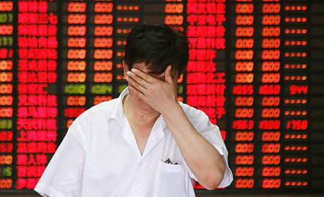 הצניחה בבורסות סין בחודש שעבר, צילום: Gettyimages, אימג