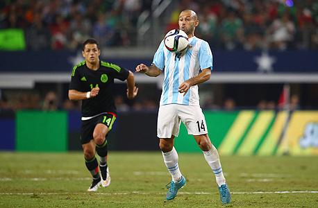 חאבייר מסצ'ראנו במדי ארגנטינה. עבר מברצלונה לסין