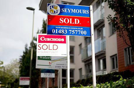 בתים שנמכרו בבריטניה , צילום: בלומברג