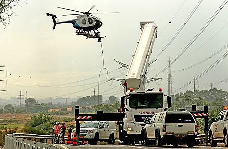 תיקוני נזק שגרמה סערה לתשתית חשמל בישראל
