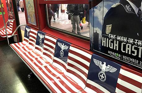 פרסומת רכבת תחתית ניו יורק אמזון סדרה טלוויזיה האיש במצודה סמלים נאצים 3, צילום: איי אף פי