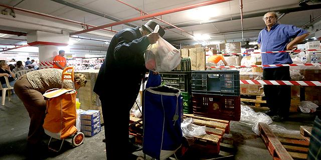 חלוקת מזון לנזקקים של עמותת פתחון לב (ארכיון), צילום: אביגיל עוזי