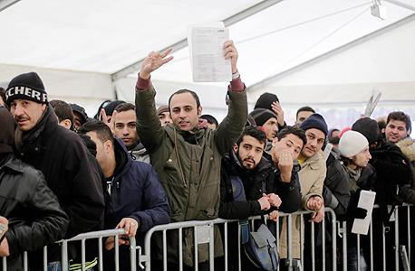 פליטים בברלין, צילום: איי פי