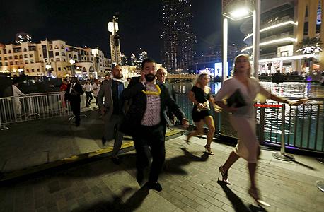 הפינוי מהמלון בדובאי לאחר השריפה, צילום: רויטרס