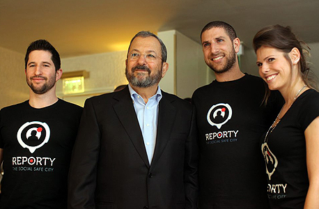Ehud Barak with the founders of Reporty, which was rebranded as Carbyne. Photo: Amit Sha'al
