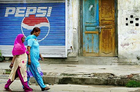 פרסומת לפפסי בהודו, צילום: בלומברג