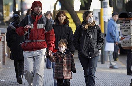 חולי עבודה: שפעת החזירים בדרך למשרד
