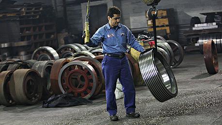 """פועל בארה""""ב, צילום: בלומברג"""