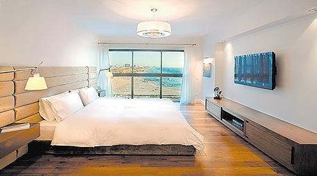 """דירה במגדל אוקיאנוס, במרינה הרצליה. הסגנון: """" אהבת הארץ"""""""