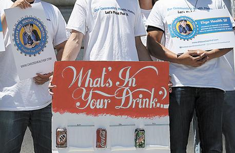 """הפגנה להטלת מס על משקאות מוגזים בארה""""ב. בסופו של דבר שינוי רגולטורי אפשרי רק אם הוא חלק משינוי ציבורי"""