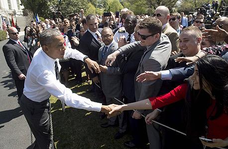 """נשיא ארה""""ב ברק אובמה באירוע ספורט של נכי צבא ארה""""ב, צילום: איי אף פי"""