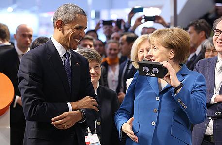 """מימין קנצלרית גרמניה אנגלה מרקל ו נשיא ארה""""ב ברק אובמה ב הנובר גרמניה, צילום: איי אף פי"""